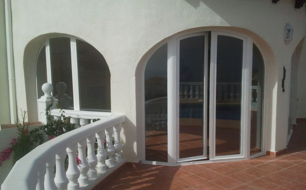 Arched double doors with side panels in a bay