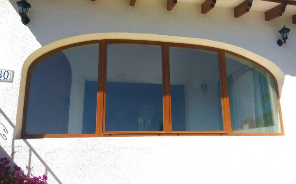 Arched double opening window with side panels
